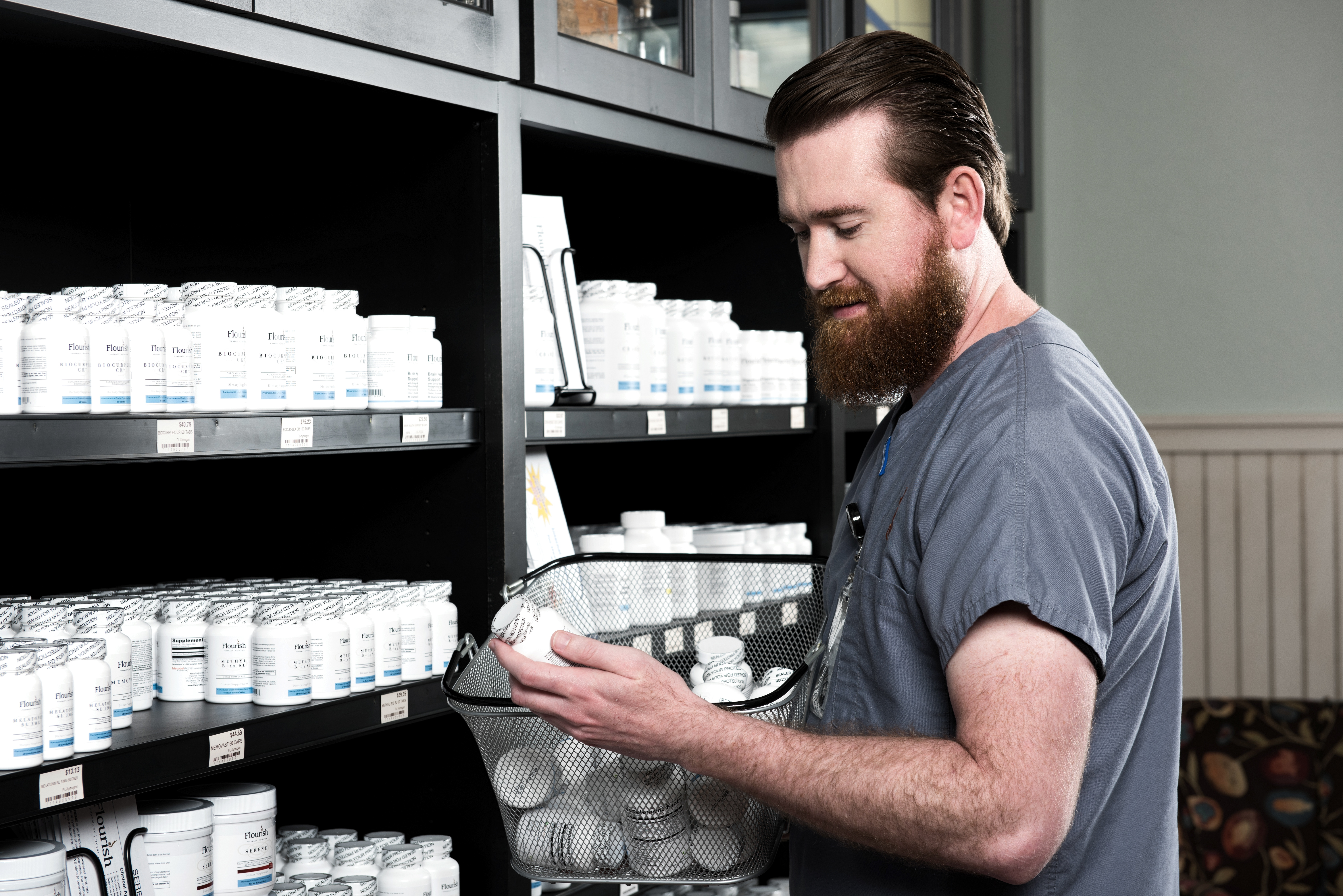 Community pharmacist receiving and shelving inventory